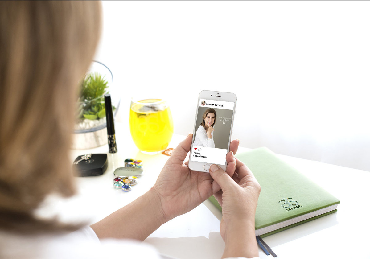 personal brand photo woman checking advertisement on her iphone sitting on her office desk