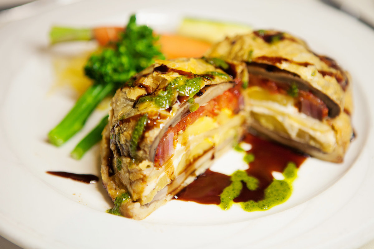 Portabella mushroom, sun-dried tomato, red onion, & blue cheese all wrapped in puff pastry