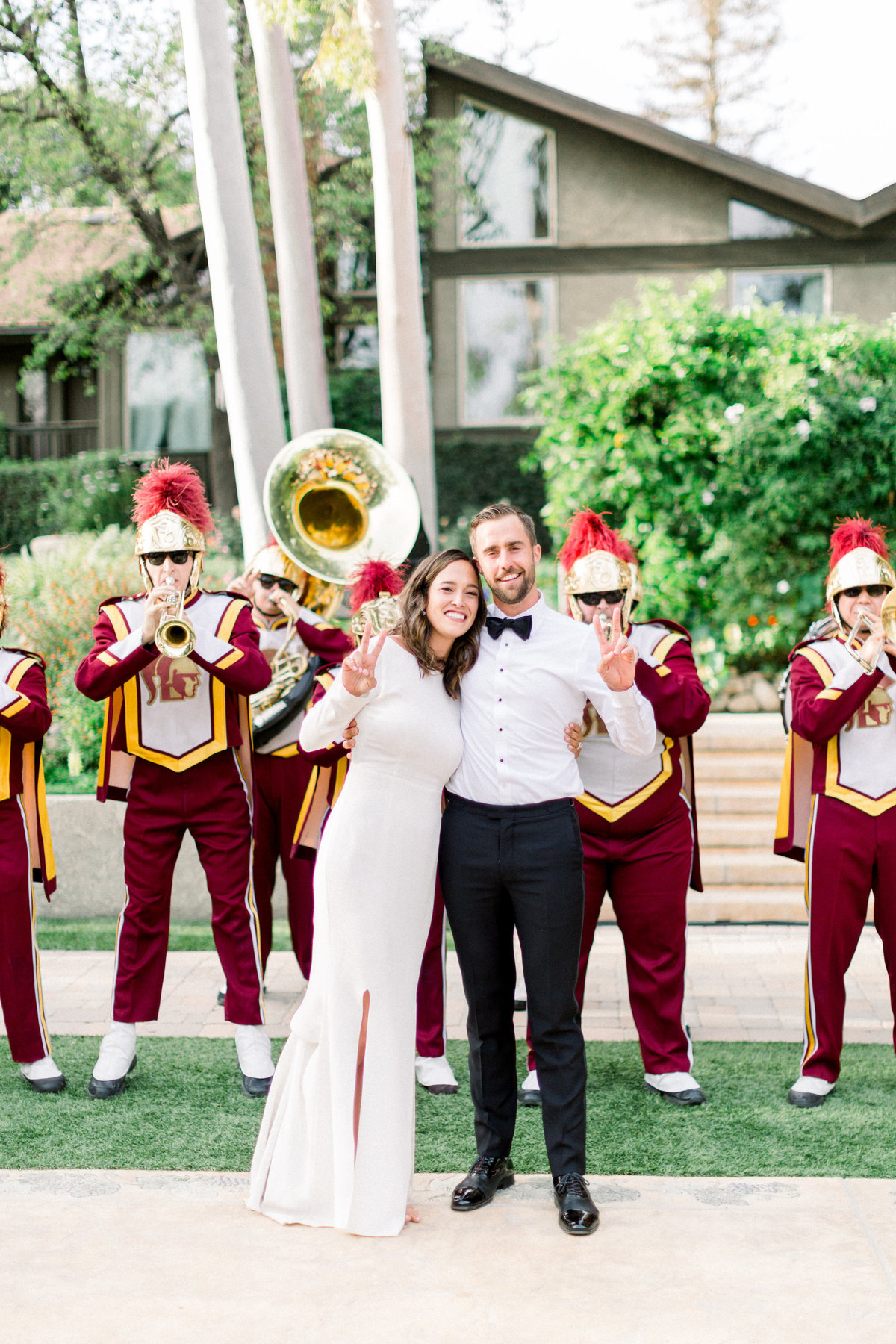 USC Marching band at wedding reception with bride and groom at Maravilla Gardens