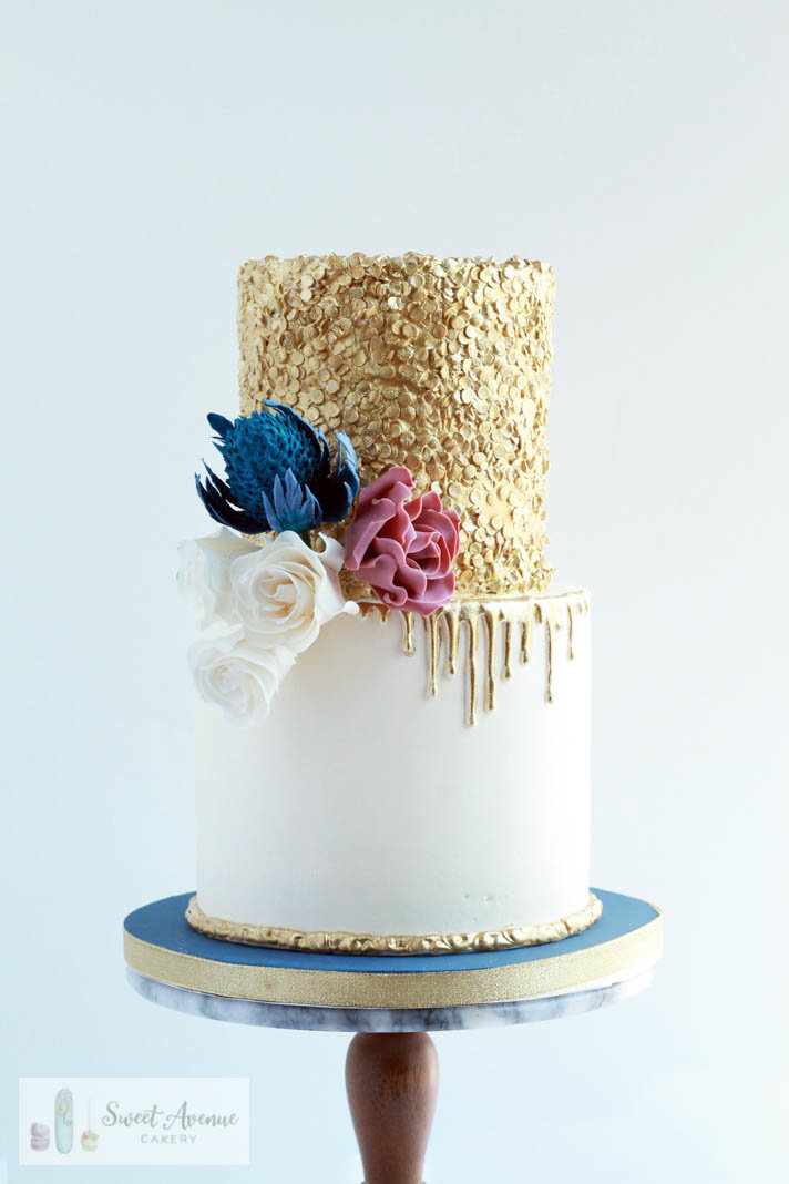 gold sequin wedding cake with thistle and roses