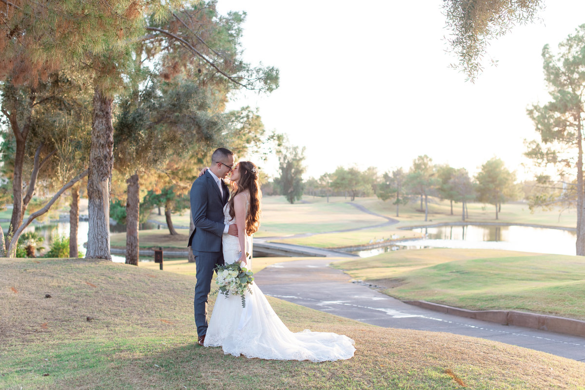 groom holding bride at wedgewood at ocotillo golf course