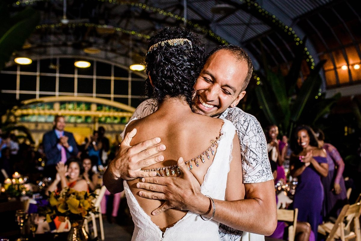 A brother embraces his sister after a heartfelt toast during a Garfield Park Conservatory wedding reception.