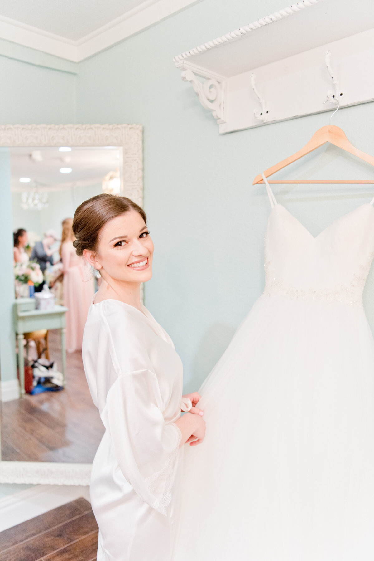 Bride admires wedding dress in Fort Worth Texas