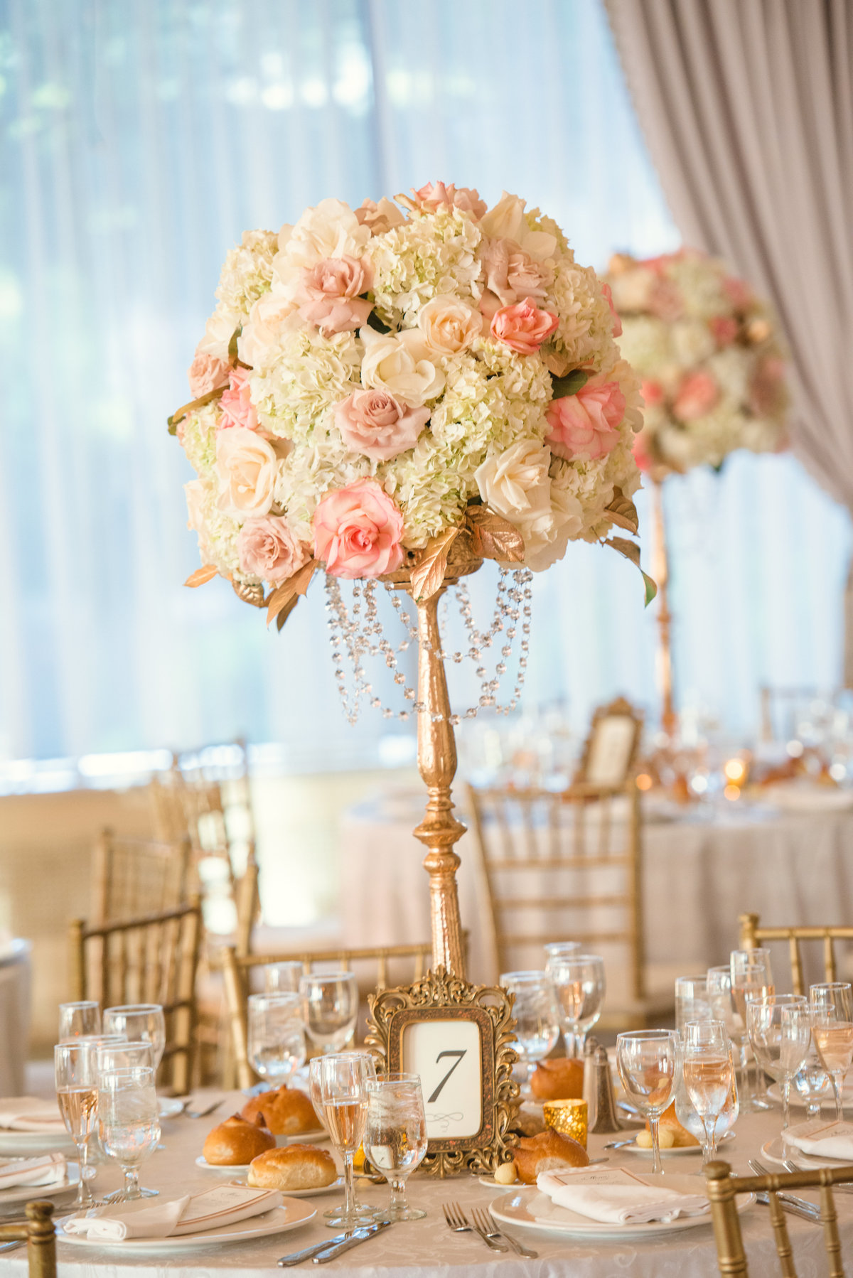 Wedding centerpiece of white and pink flowers at Glen Cove Mansion