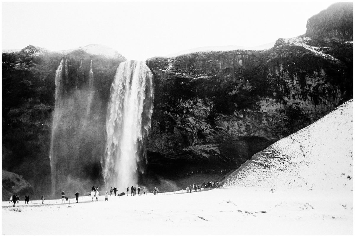 black and white photo of skogafoss waterfall in iceland