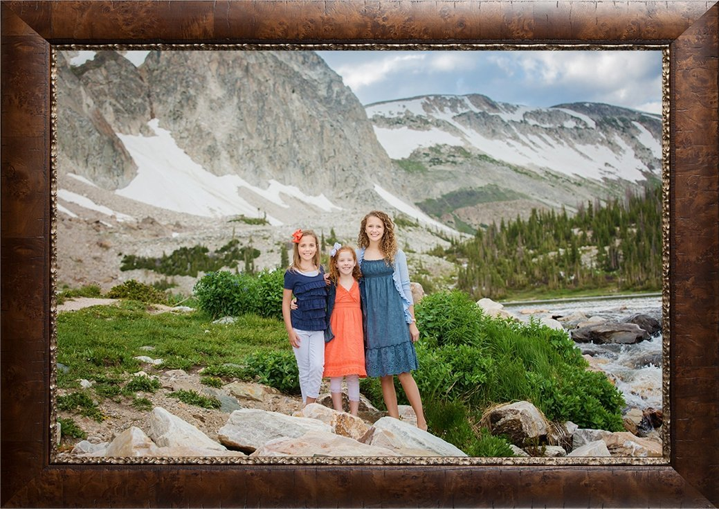 Three girls dressed in coral and blue in front of Lake Marie.