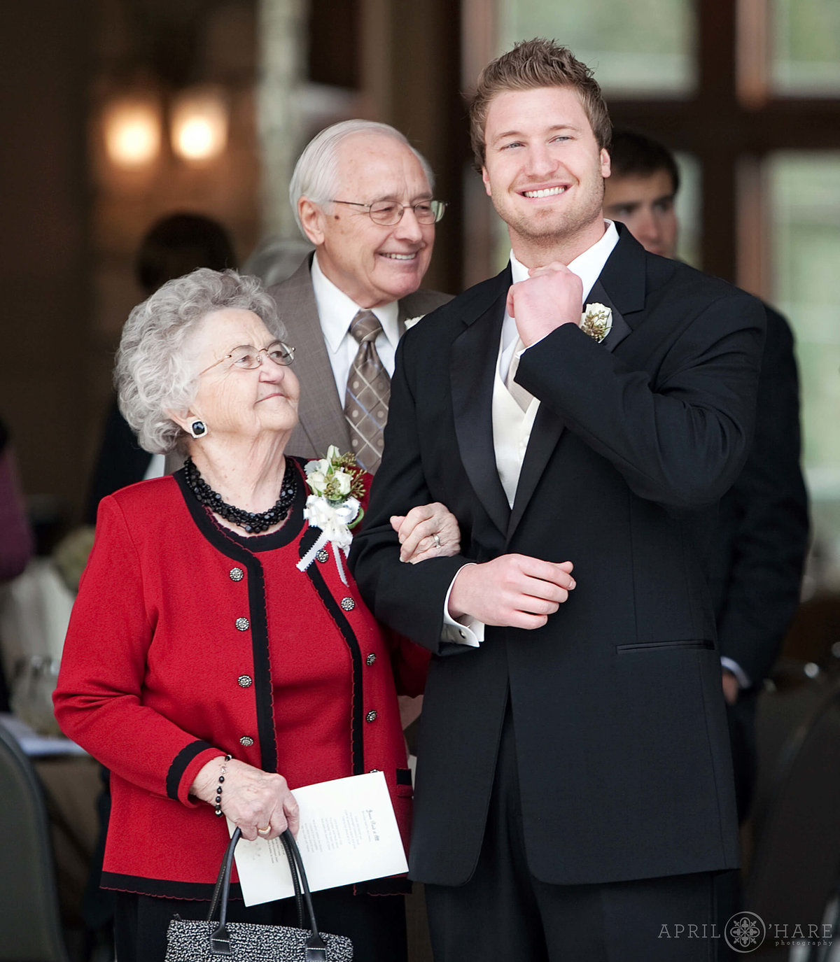 Sweet wedding photo of Grandma looking at her grandson at Cielo in Castle Pines in Colorado