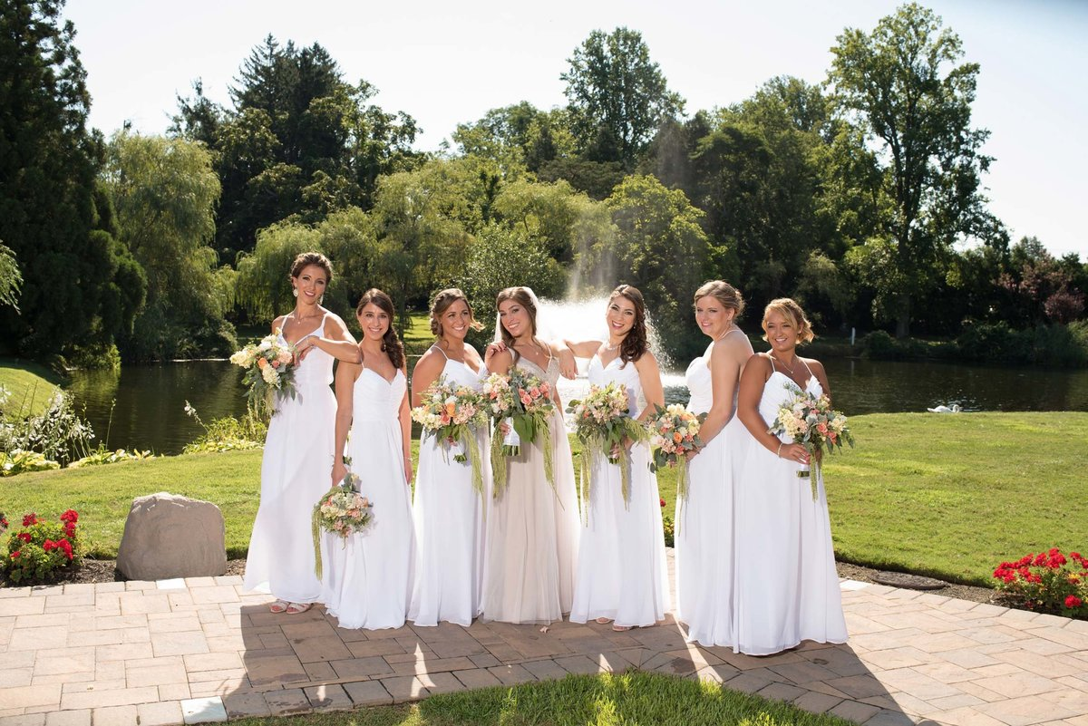 Bride and bridesmaids outside at Flowerfield