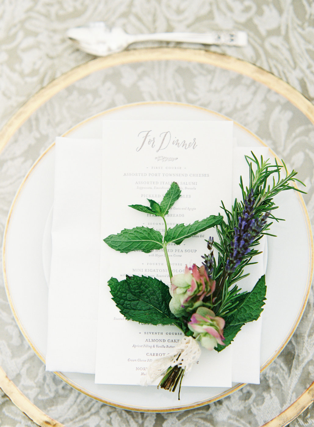 At our luxury tent wedding  each place setting had a hand tied herb posy with lavender, mint, basil and rosemary.