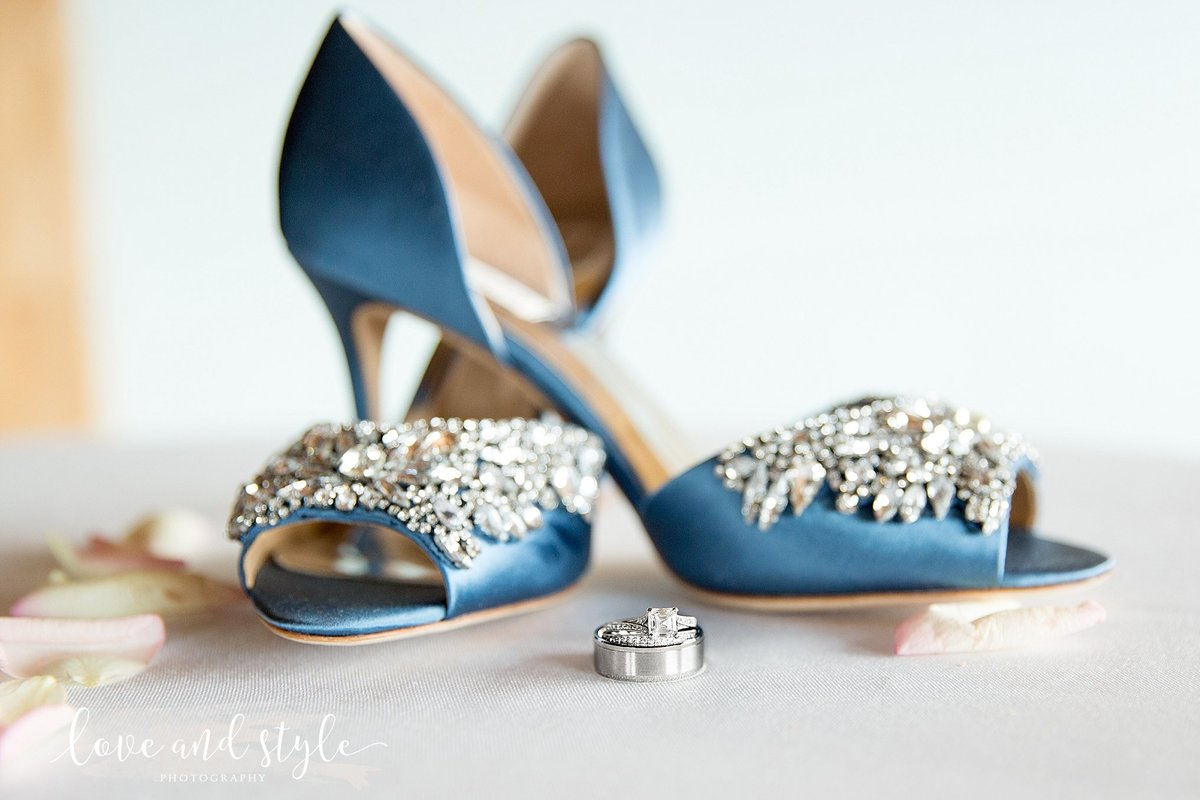 Riverhouse Palmetto Florida Wedding  Photography, Detail shot of the wedding rings and brides blue, jeweled shoes