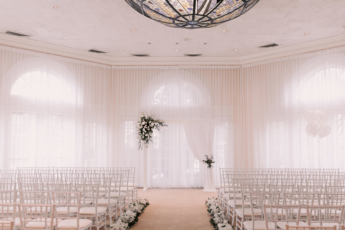 Soft light pours through the drapes in the Pavilion, illuminating the space before guests arrive for the wedding ceremony.