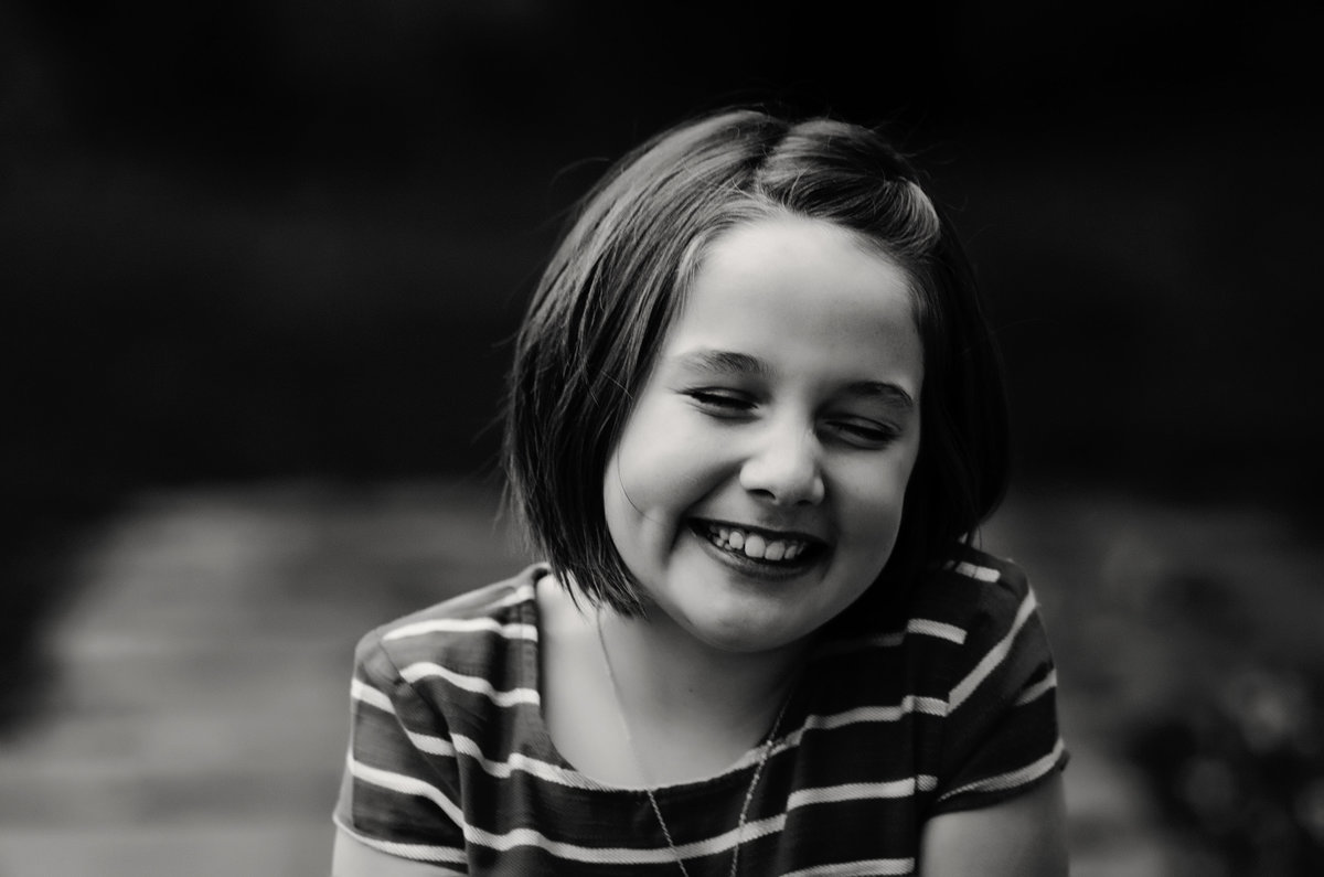 Portrait of a girl laughing at Glenview Mansion in Rockville, Maryland taken by Sarah Alice Photography