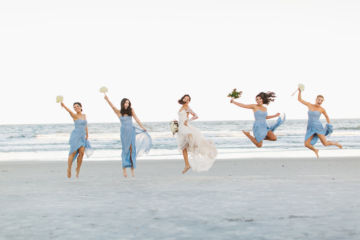 Girls jumping on the beach