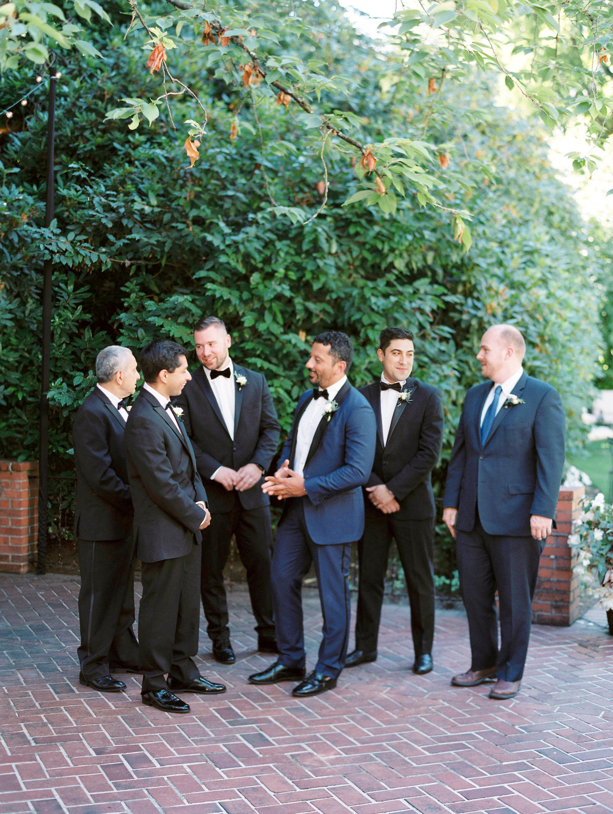 a groom with his groomsmen at the town club