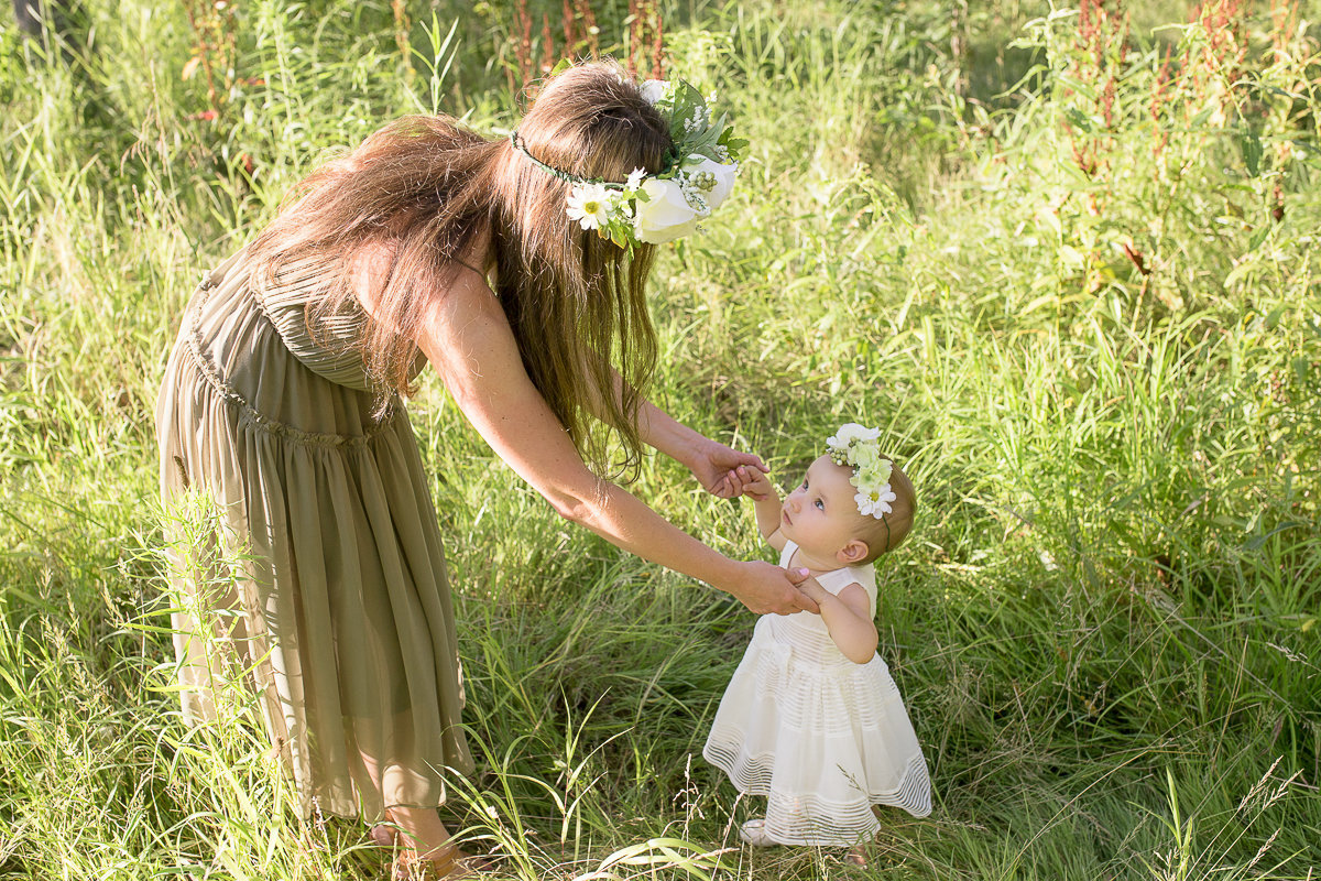 Mother and baby daughter dancing in sunny field {Oakville Family Photographer}