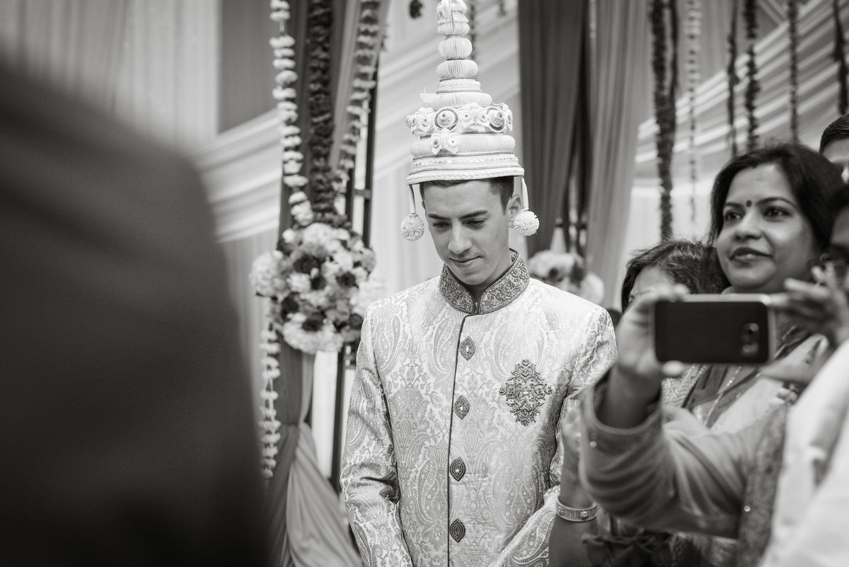 groom during ceremony at Huntington Hilton