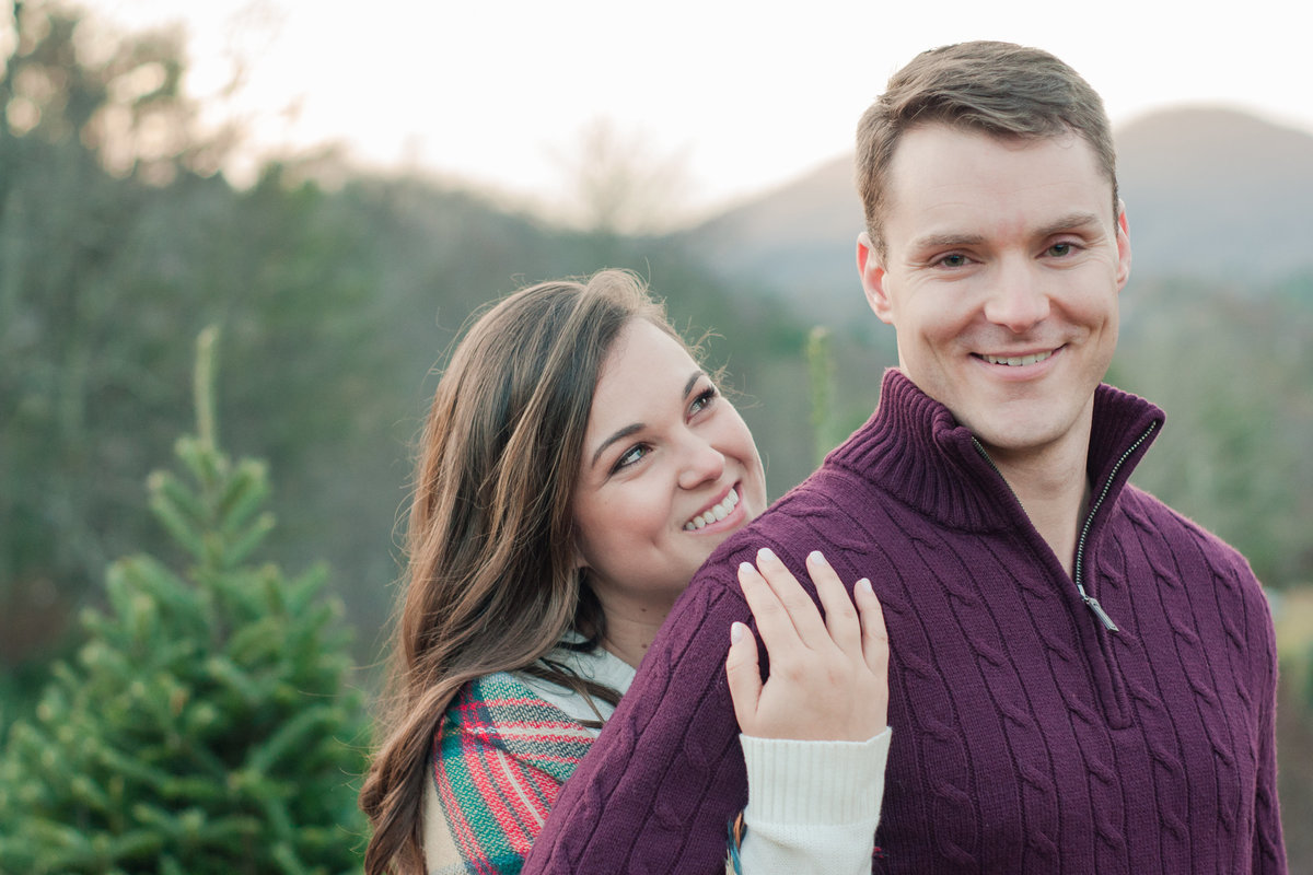 Adventurous Christmas Tree Farm Engagement Session photographed by Boone Engagement Photographer Wayfaring Wanderer.