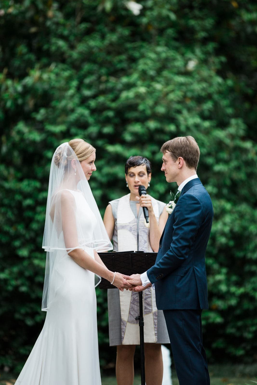 Atlanta wedding ceremony bride and groom exchange vows