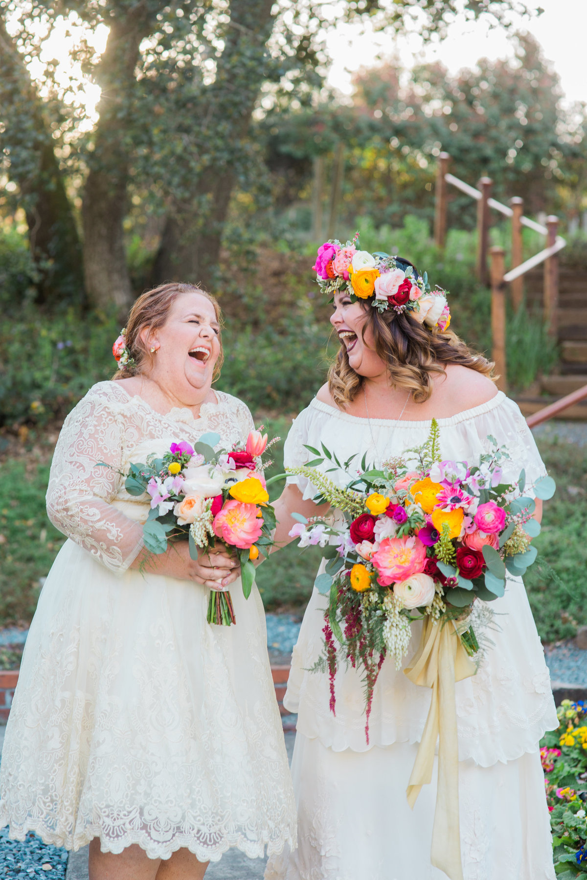 Bride and sister laughing Bride and groom joining cocktail hour at Madrona Manor in Healdsburg California.jpg