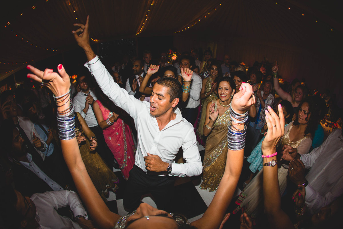 groom dancing in marquee