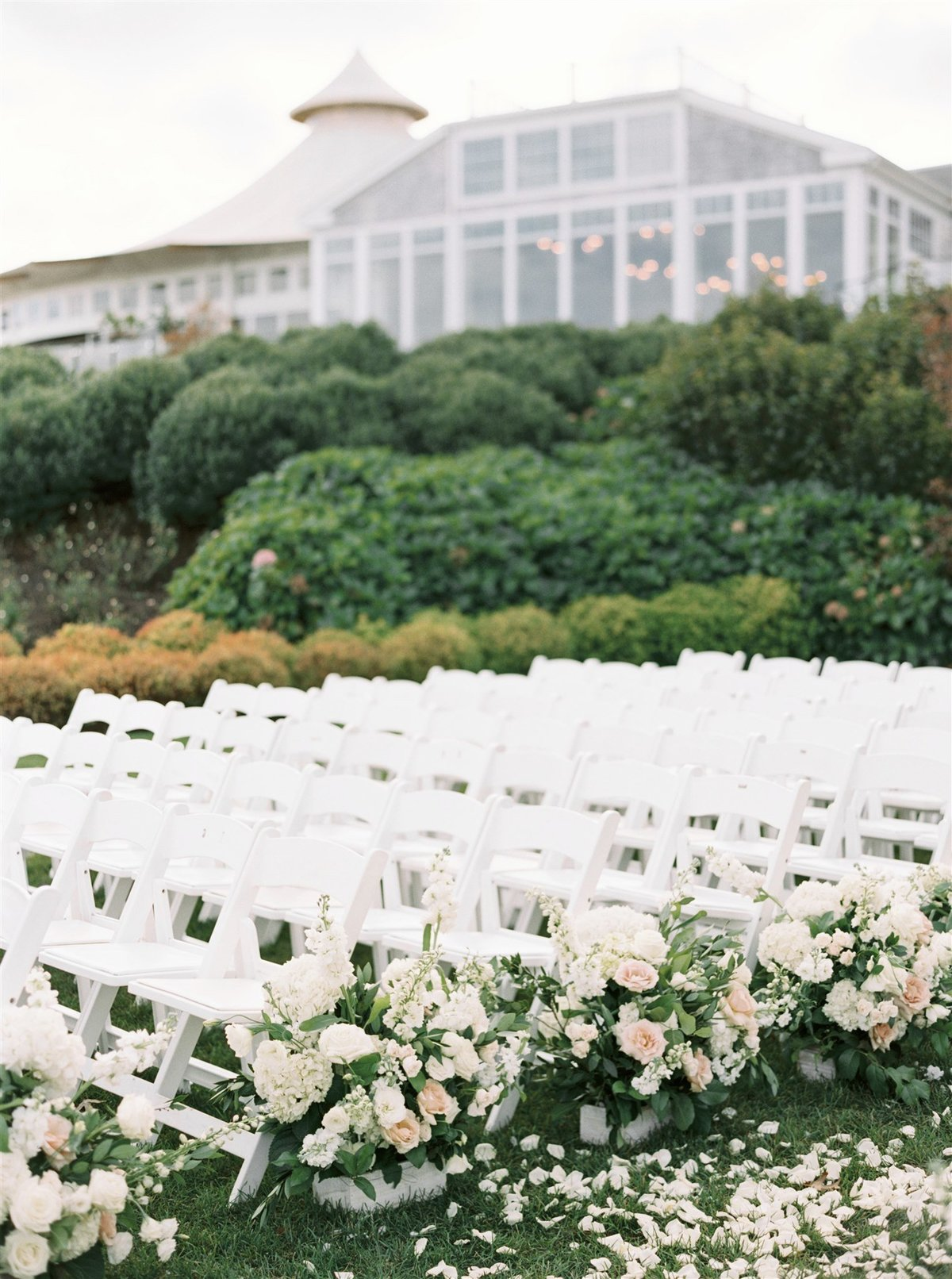 Garden inspired wedding ceremony with floral aisle for a Cape Cod Wedding by luxury Cape Cod wedding planner and designer Always Yours Events