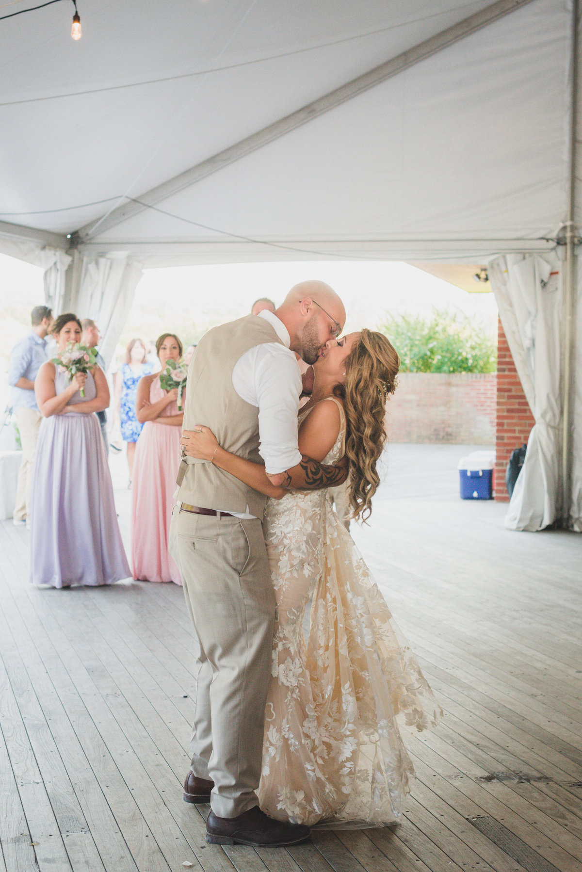 photo of bride and groom kissing on the dance floor during wedding reception at Pavilion at Sunken Meadow