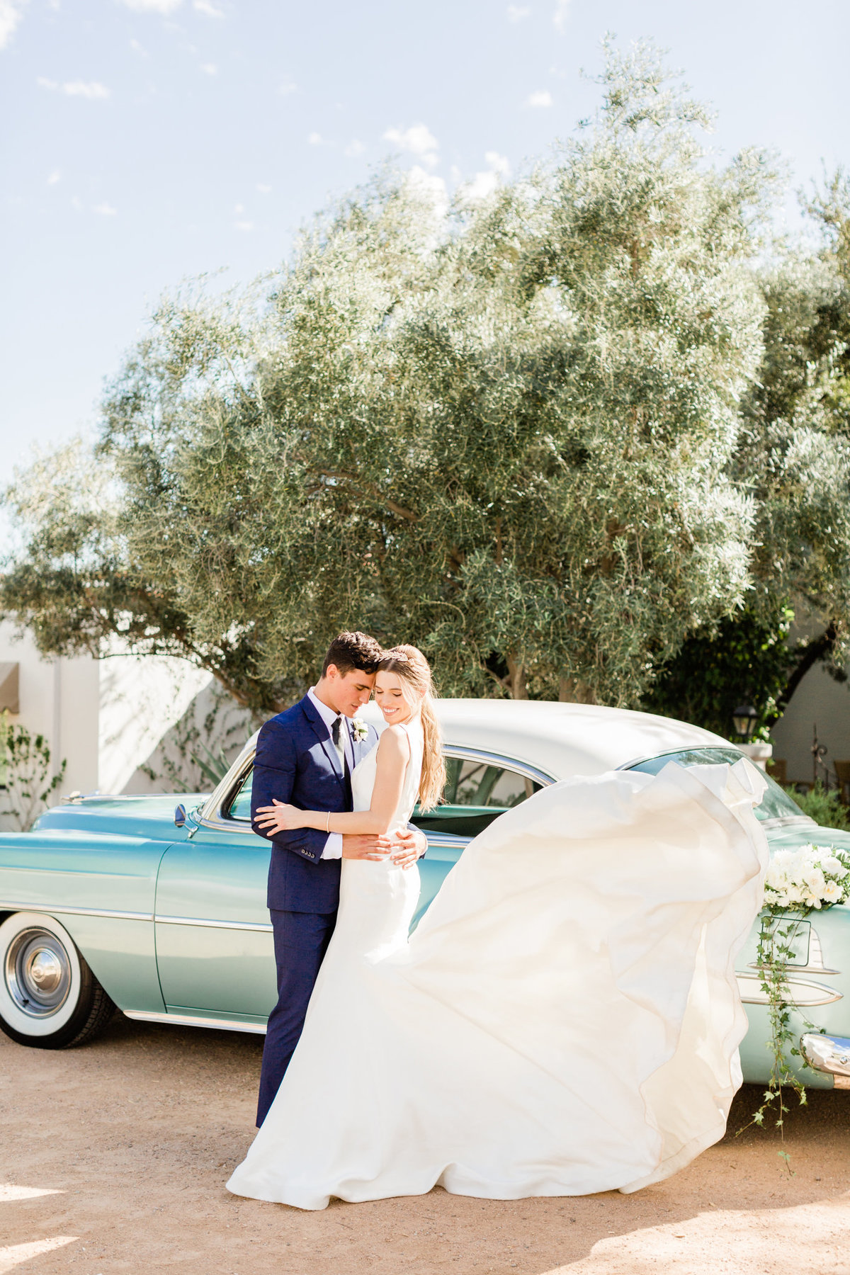 carriage house wedding gown blowing in the wind at el chorro arizona wedding venue