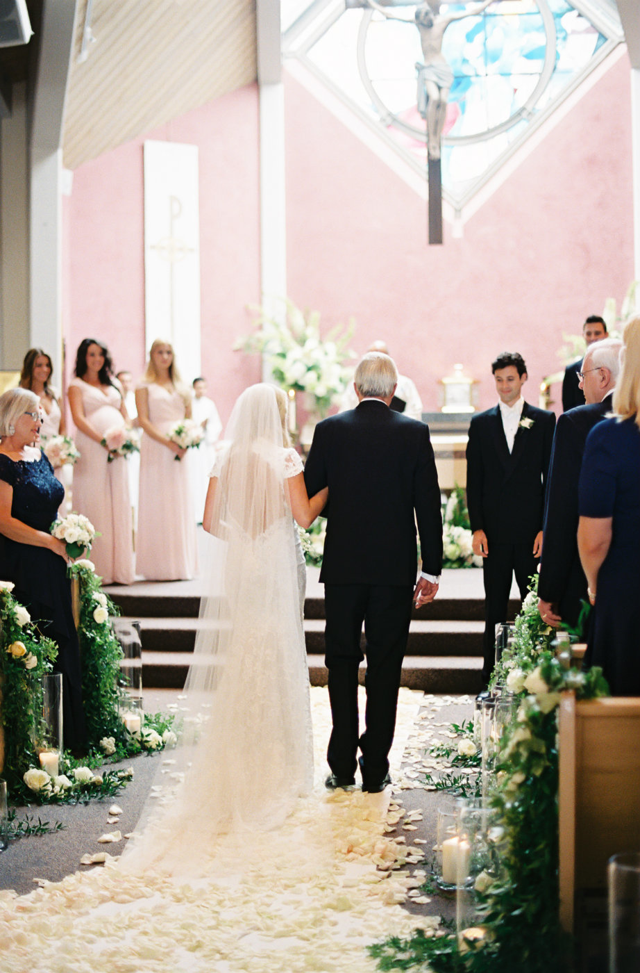 Luxury Church wedding ceremony with white rose petal aisle runner.