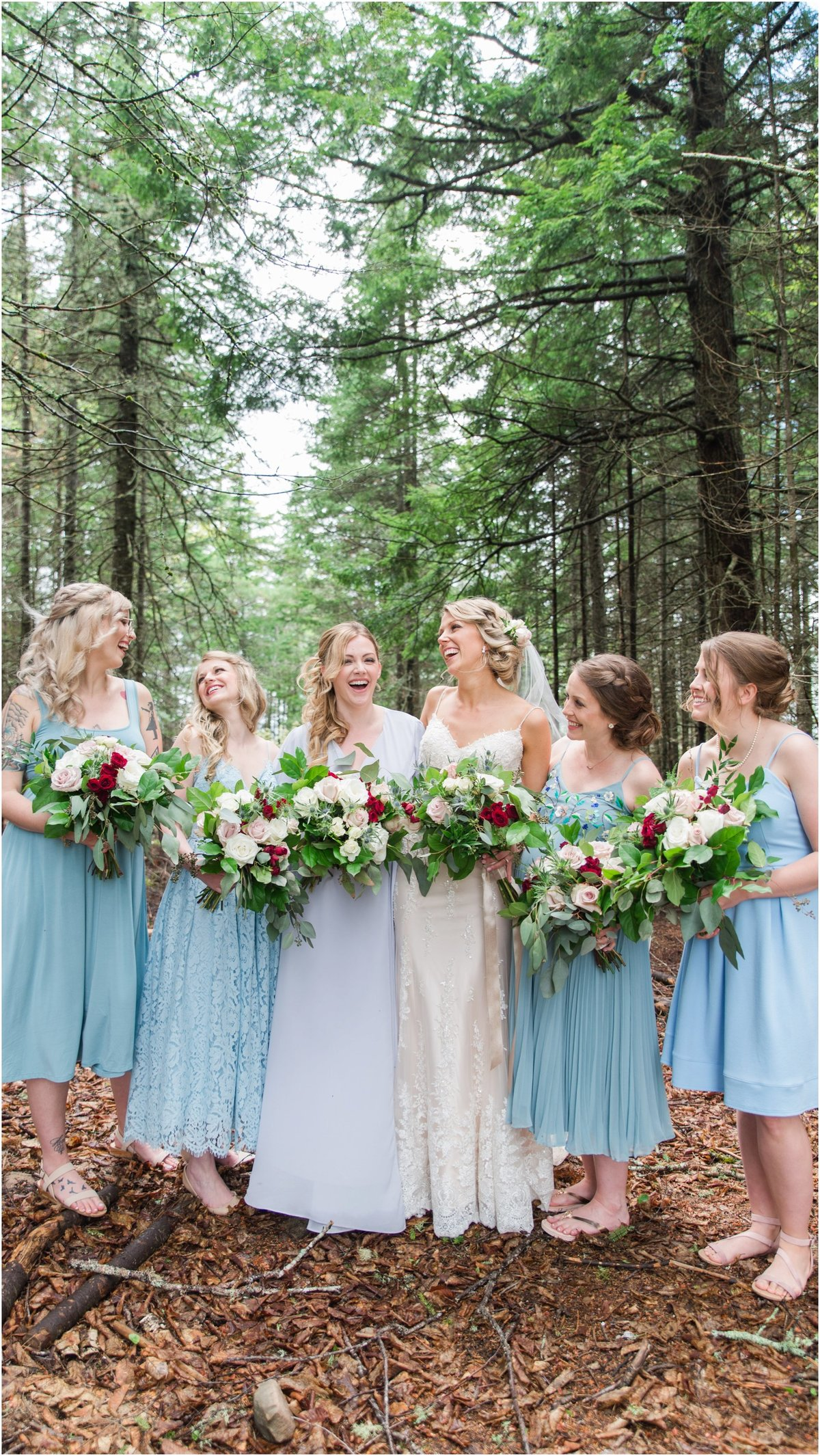 Bride with bridesmaids laughing, mix and matched blue bridesmaid dresses