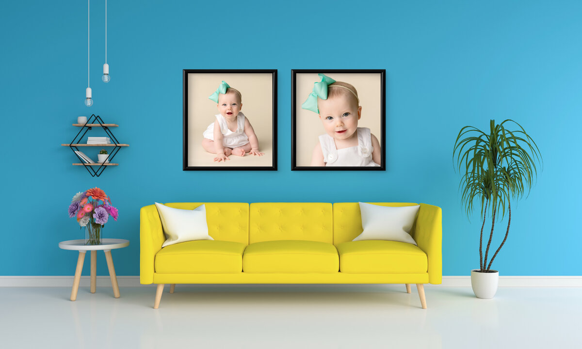 framed display above a bright yellow couch