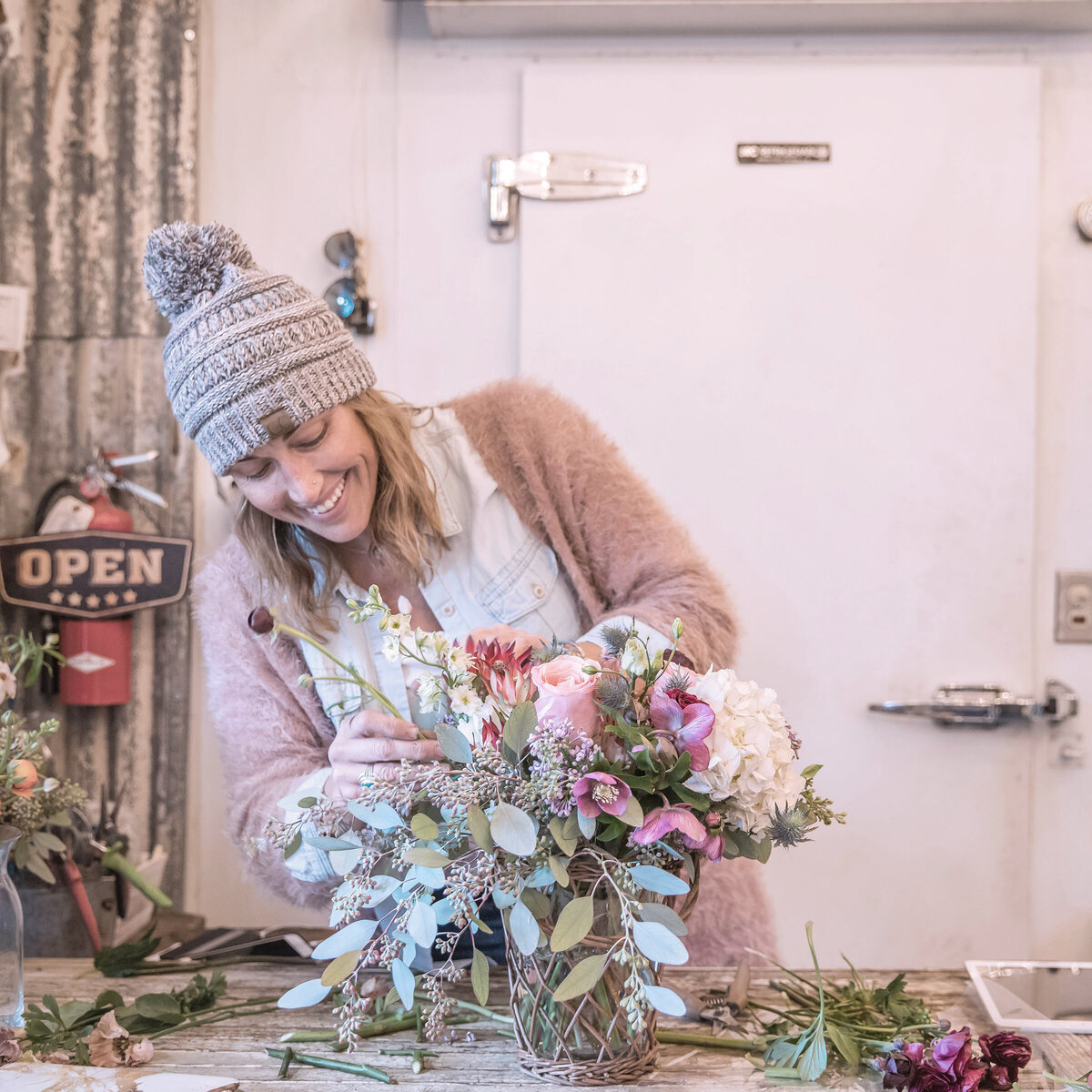 Florist in Danville California arranging flowers photographed by Nancy Ingersoll