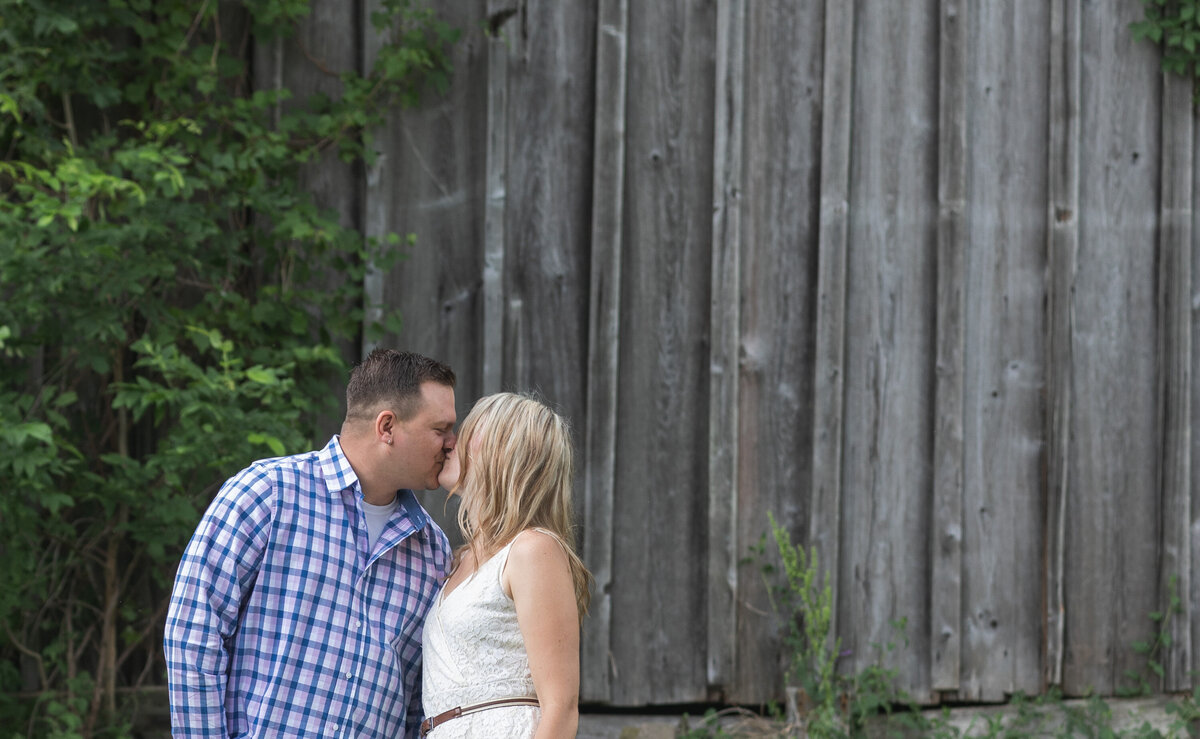 engaged couple kissing by barn farmhouse new jersey