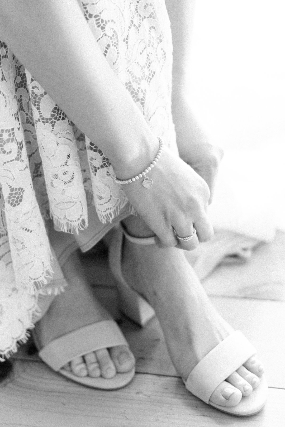 Bride putting on her shoes before her wedding at Stepstone Centre in Thunder Bay