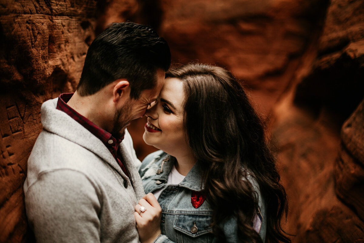 engaged couple about to kiss in red rock canyon
