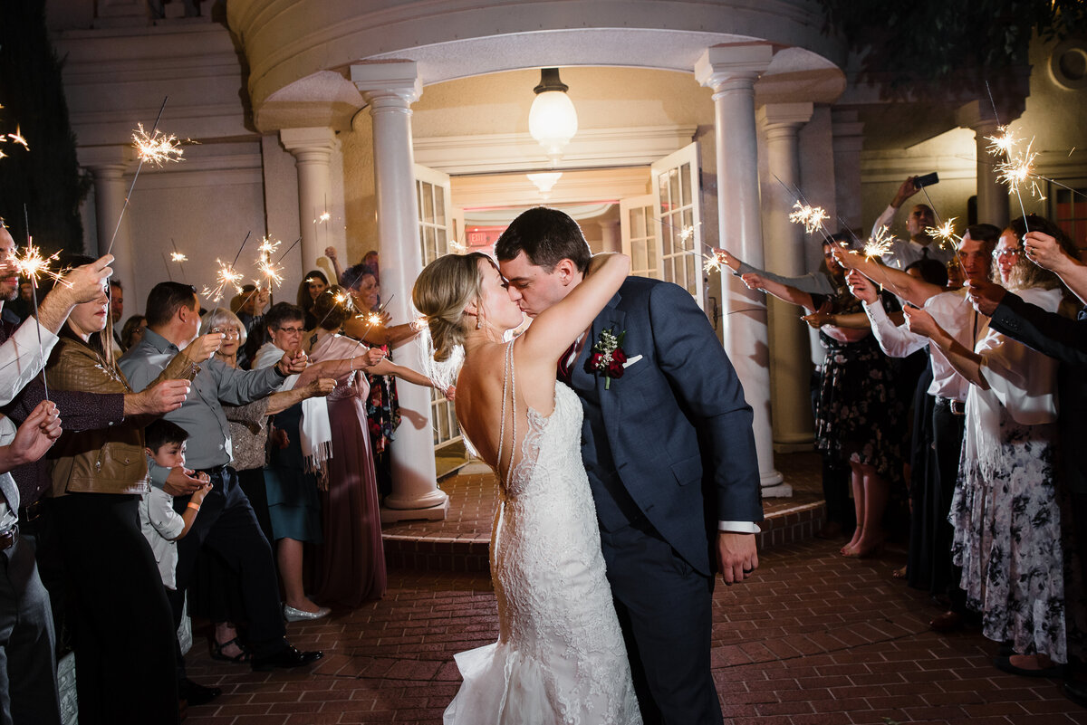 Our couple embrace as they exit the Pavilion and put their final touches on their wedding day with a sparkler exit.