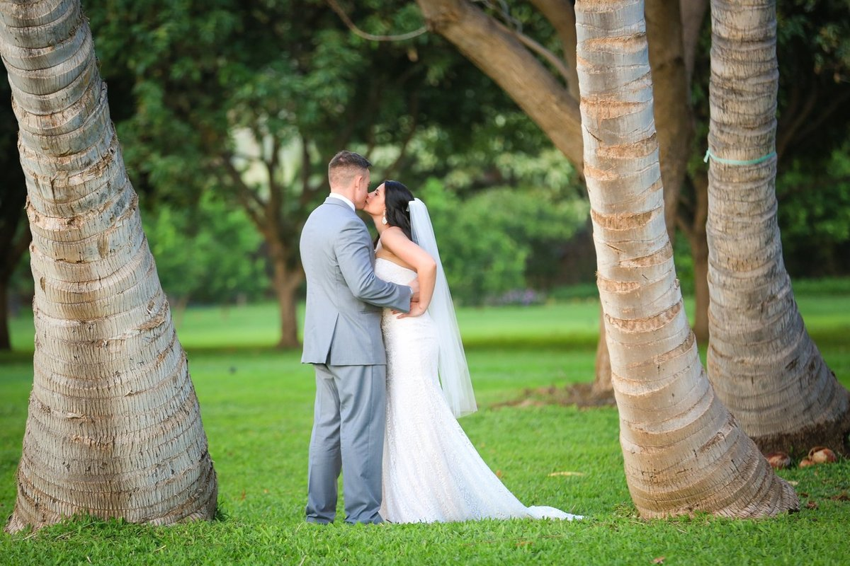 Capture Aloha Photography at The Westin Maui Resort and Spa with Wedding Kissing Scene at the coconut trees