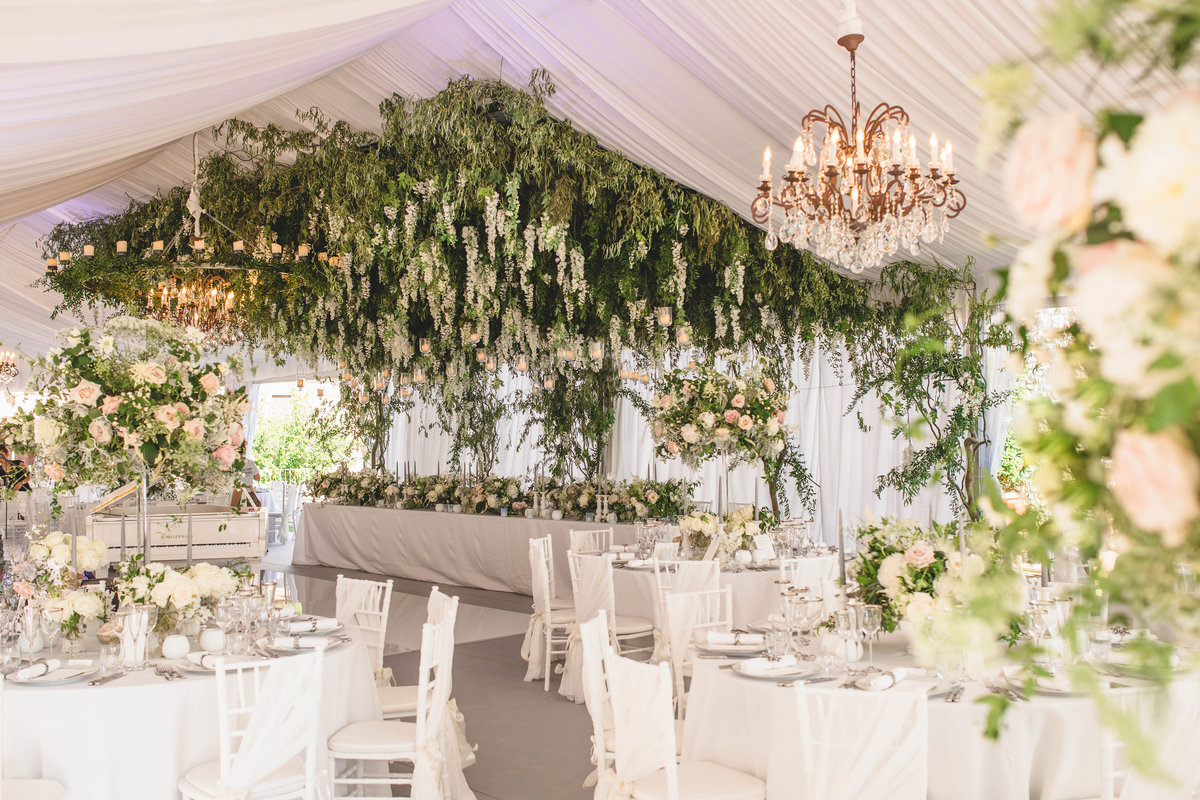 tuscany flowers wedding venue with flowers from ceiling of marquee