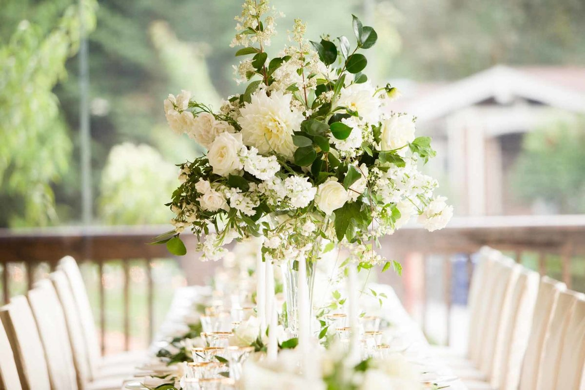 Elevated garden style arrangement with white peonies and dahlias