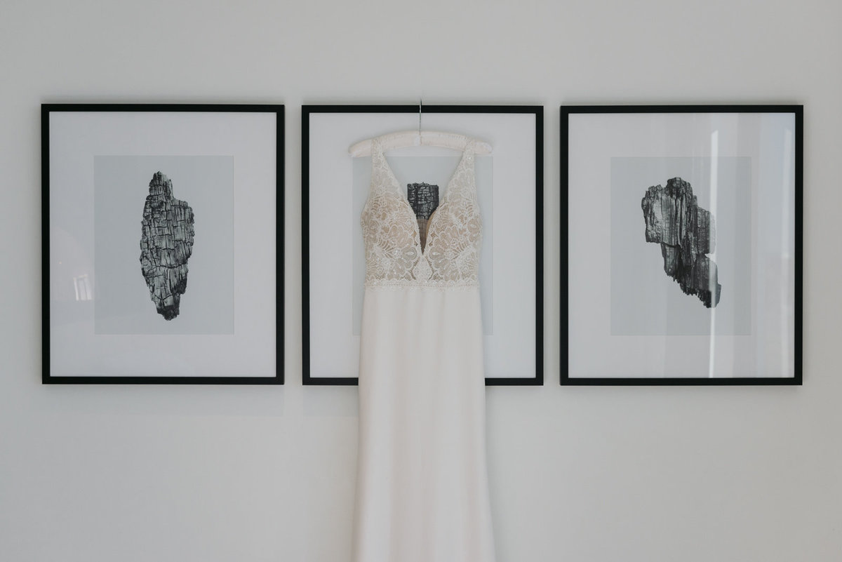 pronovias wedding dress hanging from art work at andaz hotel
