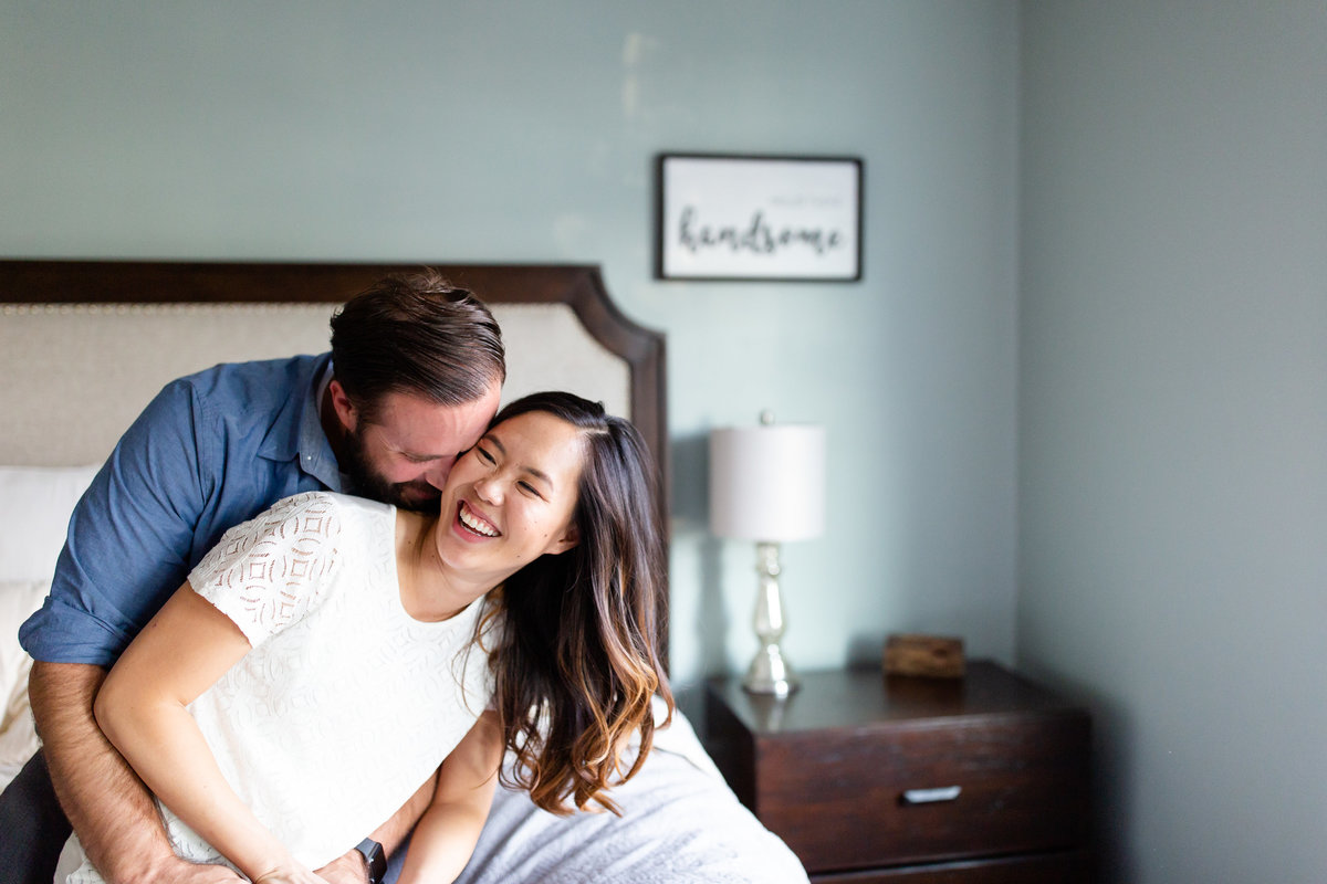 Romantic In Home Lifestyle Couple's  Session kissing  on bed  St. Louis by Amy Britton Photography Photographer  in St. Louis