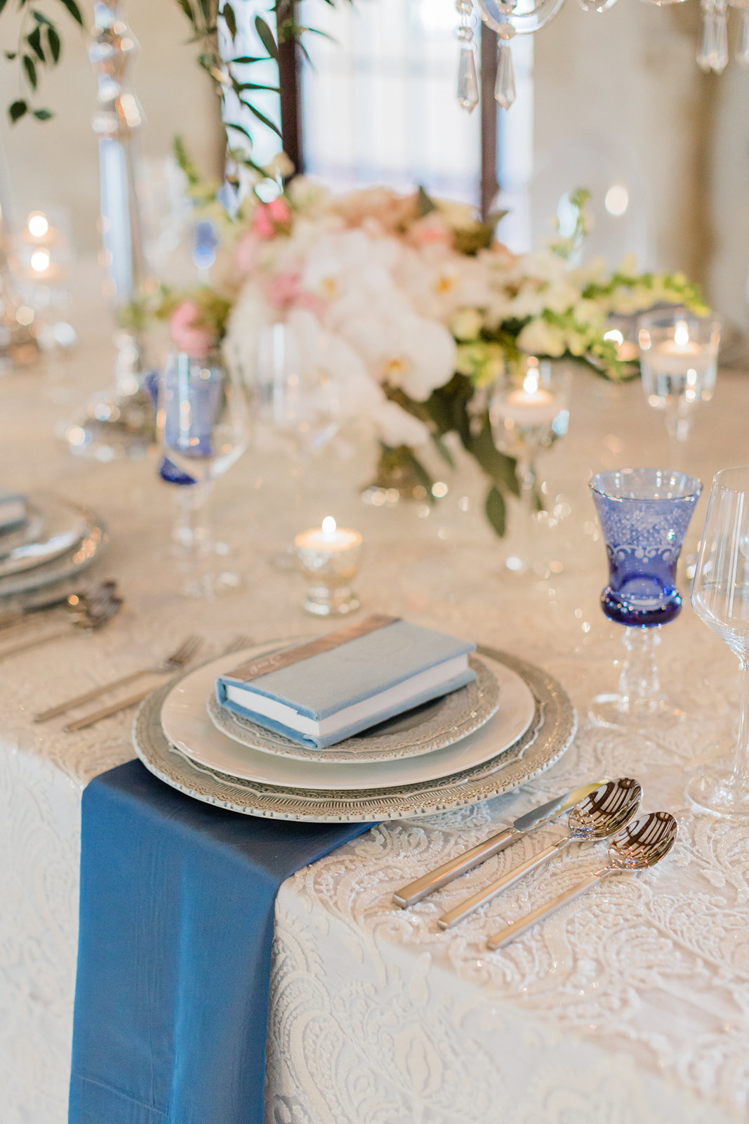 Elegant La Tavola Lace linens and Arte Italica Chargers and Water Glasses