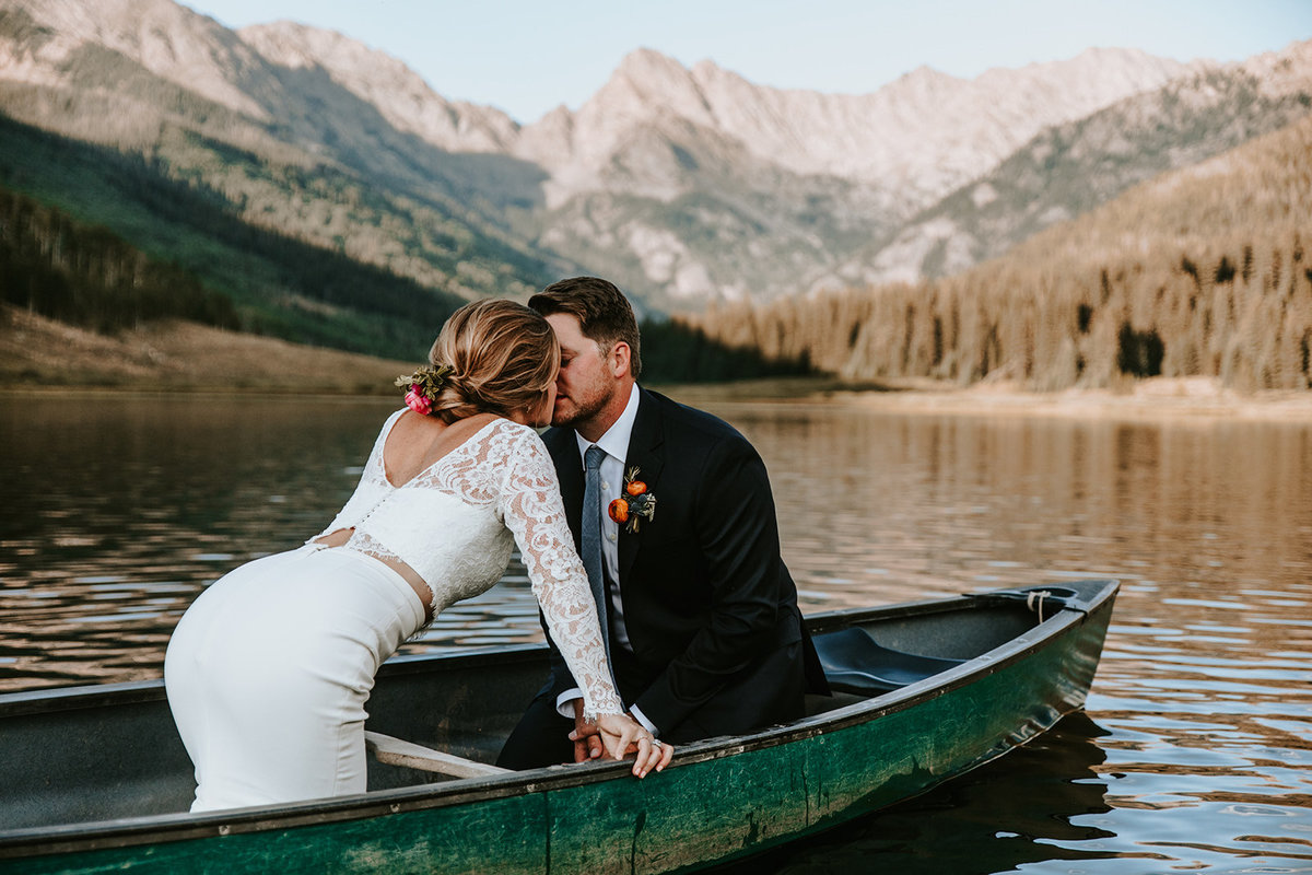 a couple kissing on a canoe at Piney RIver Ranch in Vail, Colorado