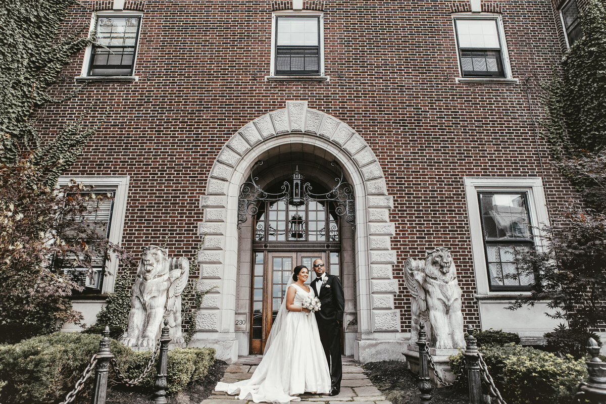 Bride and Groom standing in front of building in Buffalo, New York