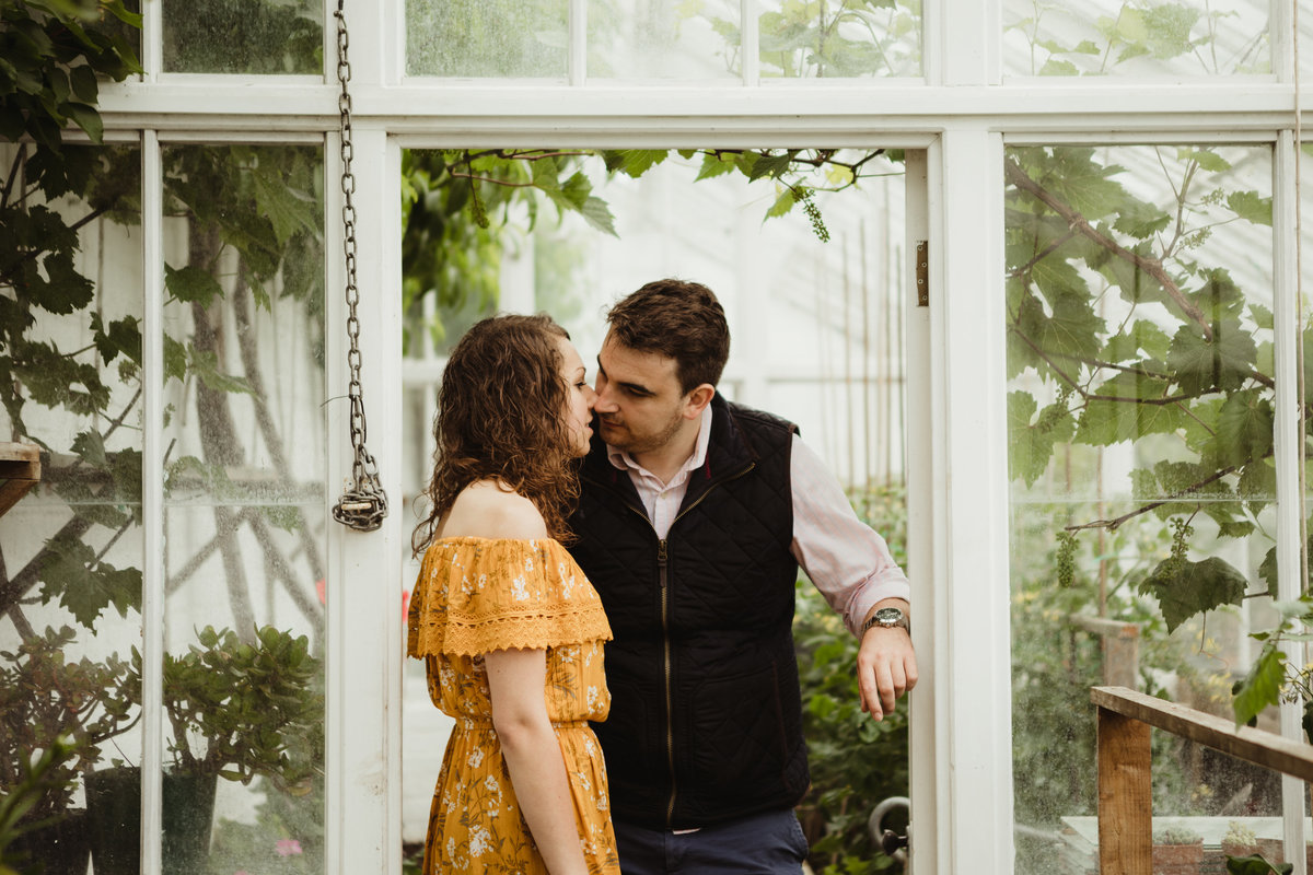 engaged greenhouse photo shoot, glasshouse engagement photos