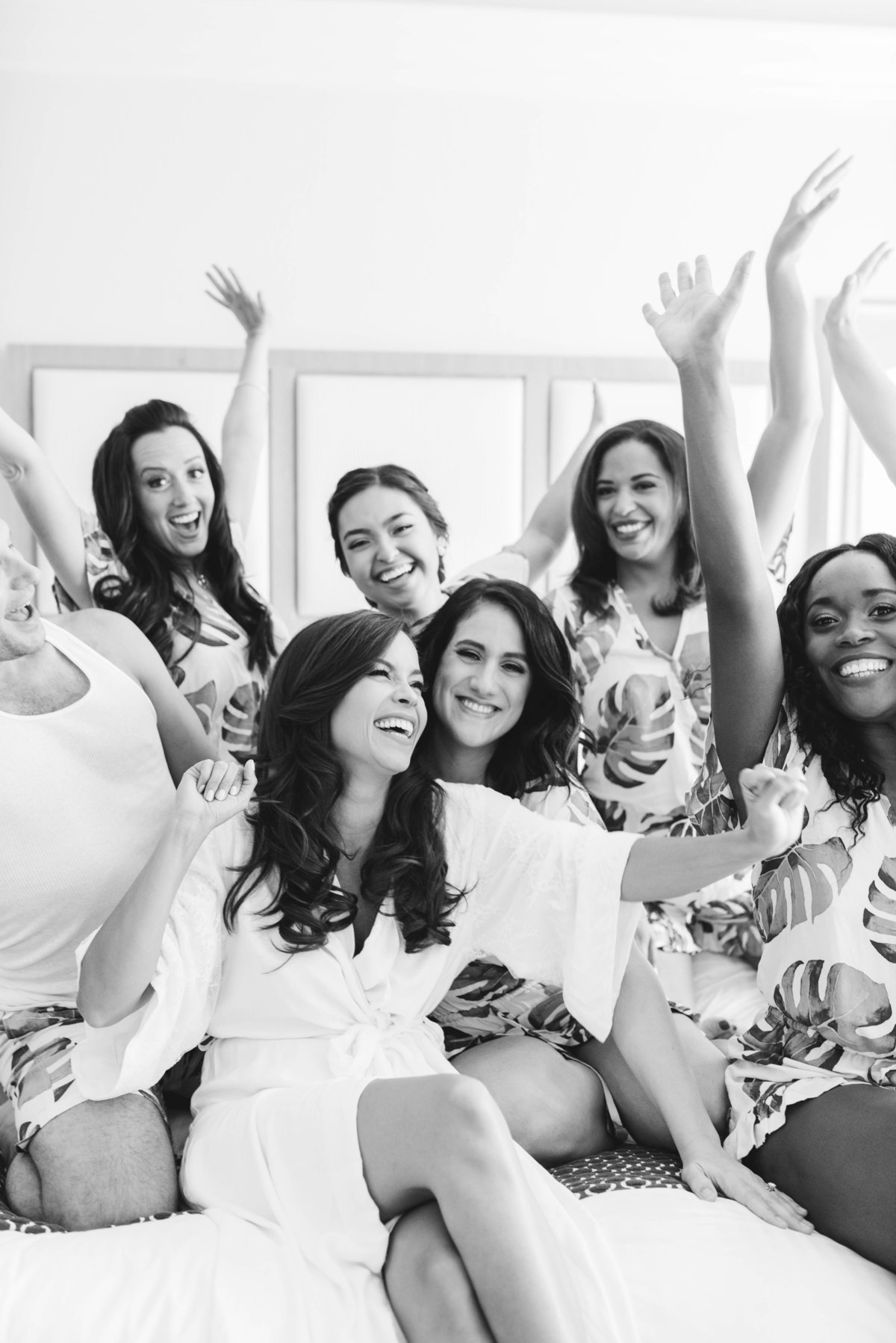 Bride and bridesmaids celebrating before wedding