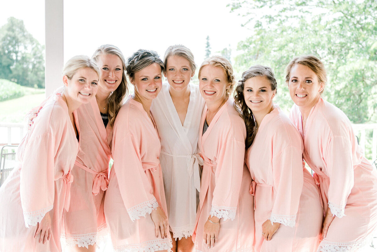 bridemaids pose in robes on wedding day