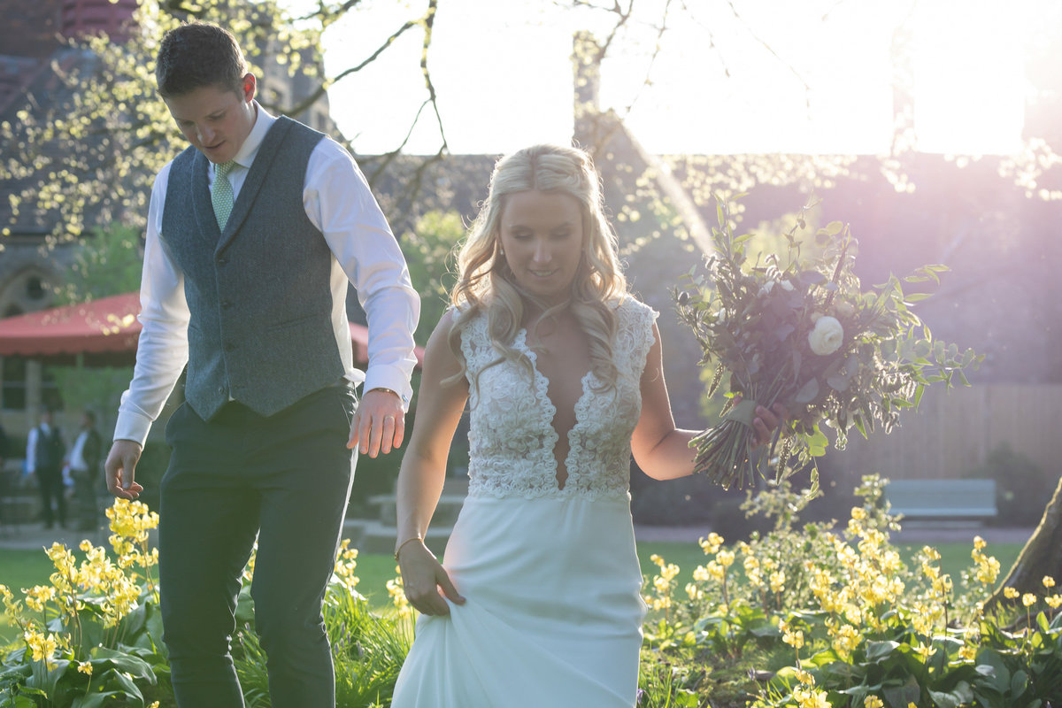 Bride and groom in evening light at Huntsham Court Devon_