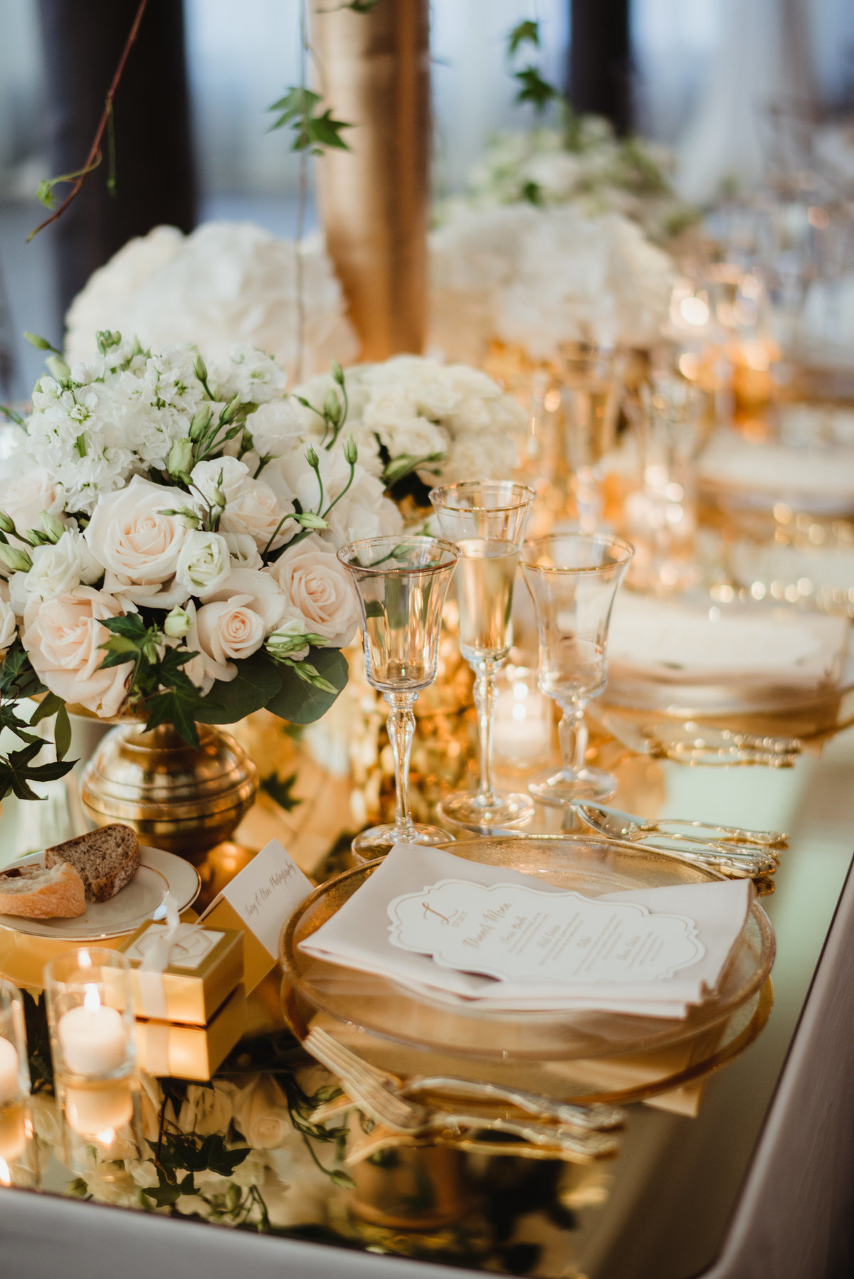 gold mirrored top, candles, white floral, reception decor