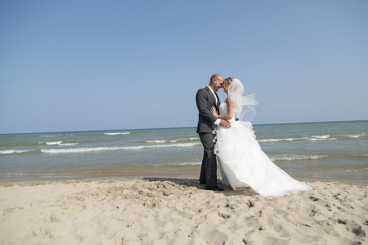1Janie&NathanWedding beach wedding bride and groom in sand destination wedding photographer