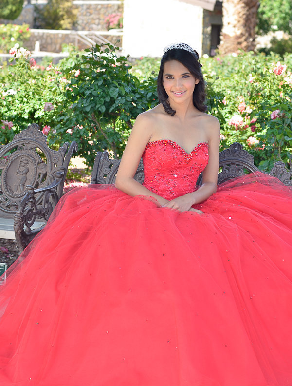 Quinceanera sitting pose